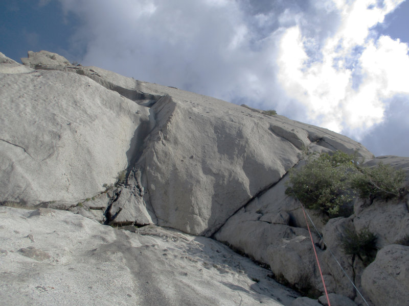 Lunch Ledge seen from the end of Indecent Exposure/S-Crack vars. S-Direct continues up the center corner, Standard Thumb comes in from the left, exits right. Might be nicer (but harder) to lieback and slab in the corner to a belay rather than...