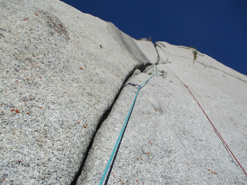Following up P4. Chad is at the anchors. The first section with tricky pro has a mysterious single bolt on the right to clip. Climbing it was very easy since the angle was very flat.