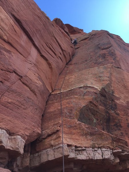 """Mark cruising up P1. The crux for me was actually getting off the ground and into """"lie-back mode""""."""