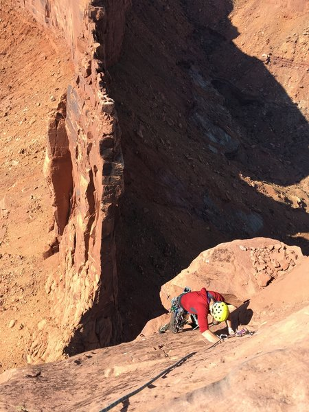 Final slab section of pitch 5. the route traverses to the arete out of view to the right