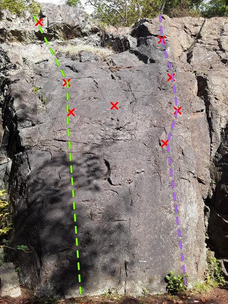 Visible routes on NM wall from approach trail. <br> Green is Washing the Elephant<br> Purple is Just Barely Hanging On<br> There is a single rusty bolt between the two routes