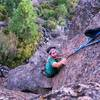 """New climber Josh topping out on the anchors of """"Ajax"""""""