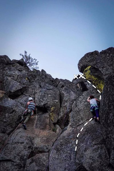 """Climber on the right pulls through the first crux of """"Boner"""", while Cory (left) leads the crux of """"Draino."""