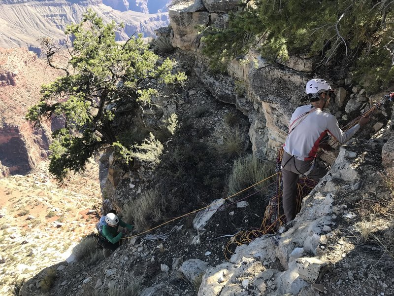 Carlos brings Shelby up on belay from the top of the third pitch.