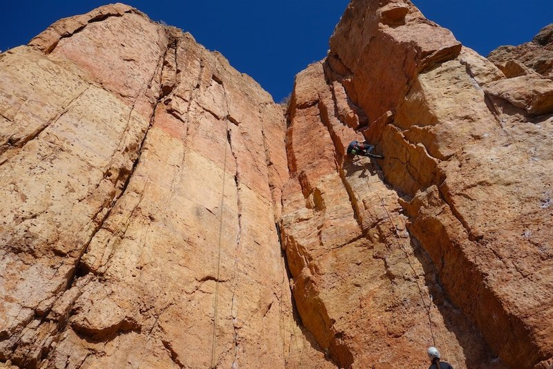 A rope is hanging on I Claudius. The climber is on LaCholla Jackson.