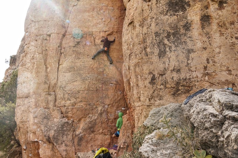 Tony N. trying to stay warm on 'ReGroovy'... an aptly named route. Afternoon was maybe not the best time to try....<br> <br> Photo by Jeff Sung.
