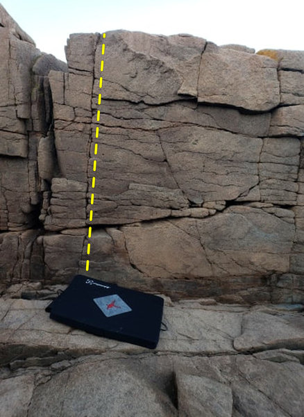 Follow the crack up from the upper left corner of the mat, just left of the topo. Reach for the topout.