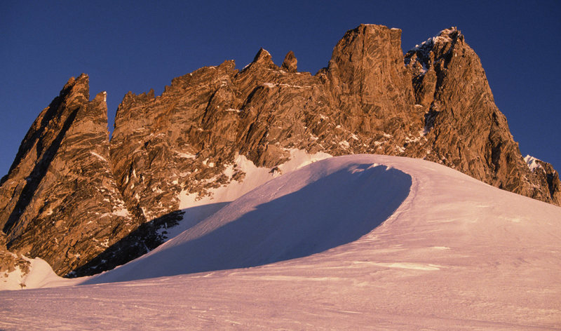 Sunrise view of the Tooth and the main peak of Mt Waddington from our high camp.