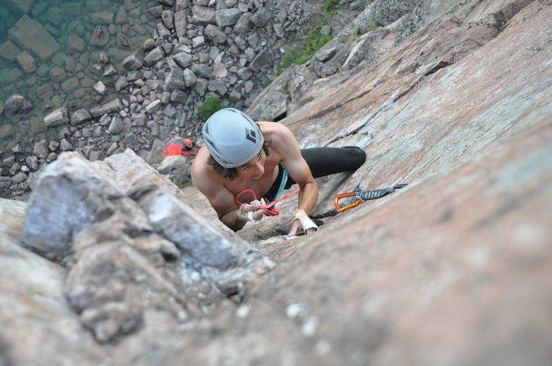 Clipping the Piton at the crux