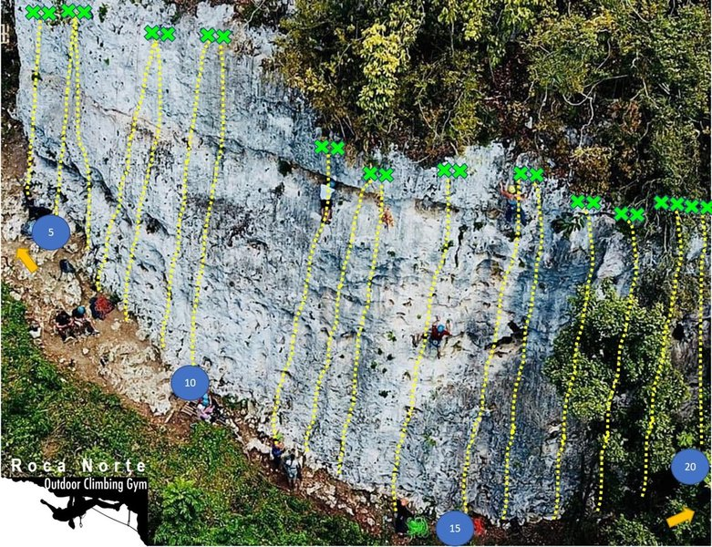 Order of routes number 4 to 20. In the crag only those having a number circled in blue appeared tagged with a blue tag (every 5). Follow this numbers in the routes list and you should be able to find everything easily
