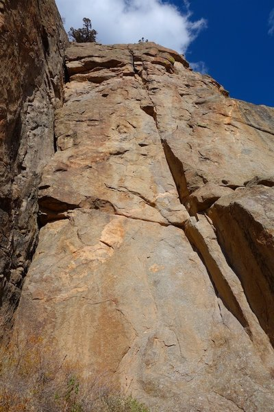 Pitch 6 (5.11 option). Happy Ending climbs the crack system starting in the lower right of photo.