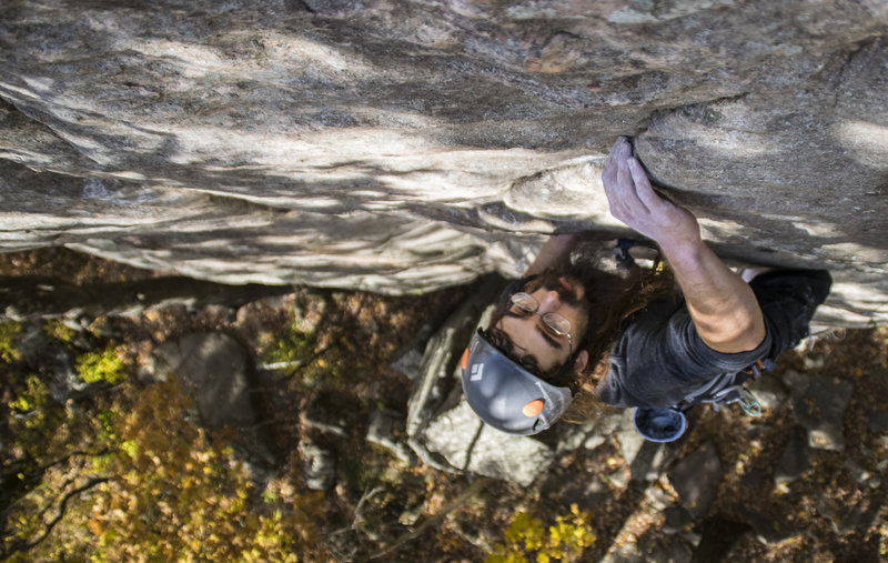 Pulling the top-out moves on the OS. <br> Photo: Alex Beld