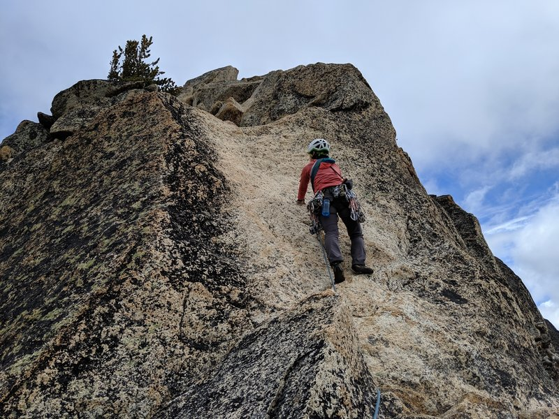 Looking up at the slab boulder problem on the final pitch of the Beckey Route