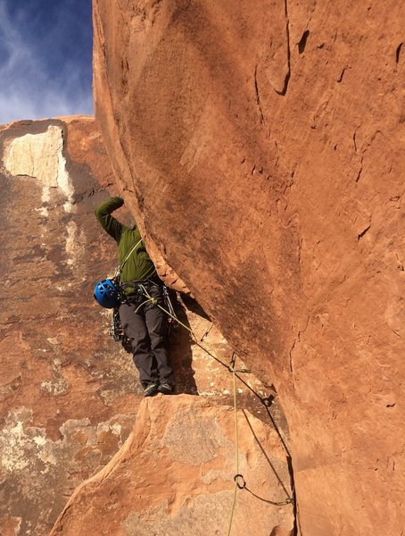 Josh- the headless climber-topping us out via the tricky, overhung OW