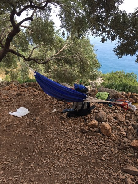 """Hammock (not ours) slung near """"Ilektra"""" with view of the ocean."""