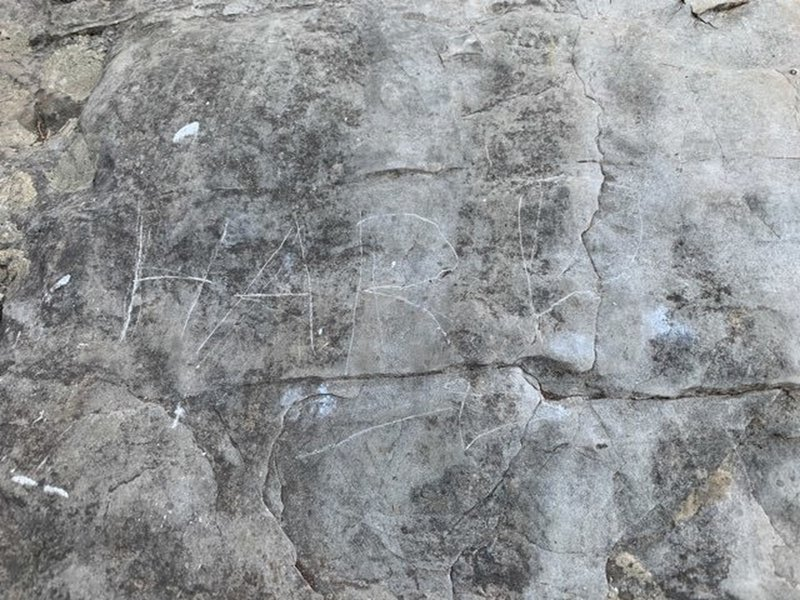 """Why in the world would someone feel the need to deface the rock like this? Perhaps this is their English translation of """"Fuerte"""" which is written in paint directly to the right."""