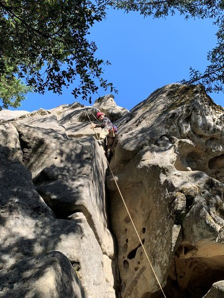 Climbing Chock Stone after passing the crux.