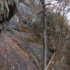 Relapped, overview of dirty gully and start of climb. Steep slab with bolts is seen middle high in the picture.