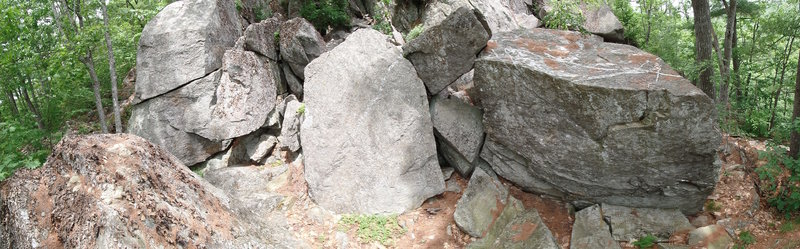 The backside of the Buried Treasure boulder (right), Tombstone boulder (center), and the Mullet Wall (left).