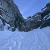 """Top of the Couloir.  Forrest Voss climbing to the base of the mixed """"head wall"""" that puts you on the ridge."""