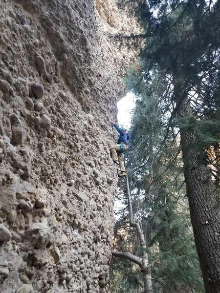 Aj about to go around the corner at the crux.