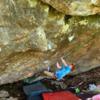 Dan Lenzi on 'The Crack' V5 on the Geo Cache boulder.