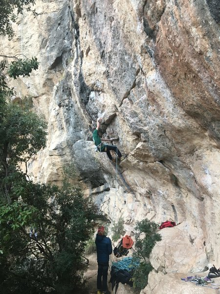 Unknown climber getting into the lower crux