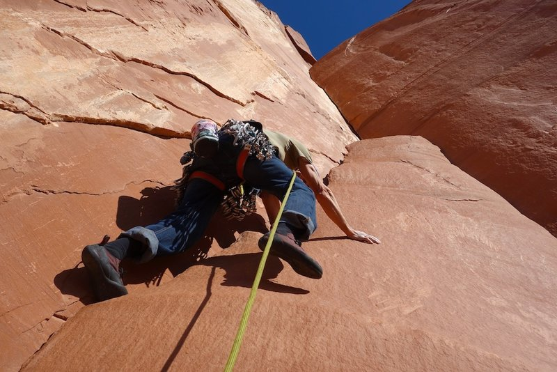 Starting up the pillar to access the corner on Pitch 1. You can also climb the right side of the pillar.