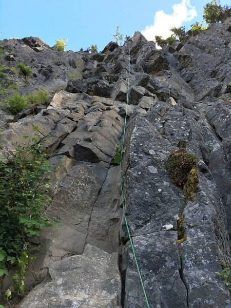 Medicine breaks right of Basic Needs (rope line) above largest roof to right of rope; finishes on and to right of the sharp arete at top