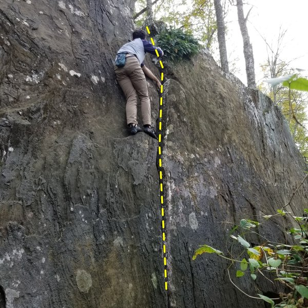 Climbing Crack which leads to big ledges for a good topout<br> Great for a warmup!