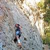 Maidy climbing in her C4-resoled Chuck Taylors at Malibu Creek.