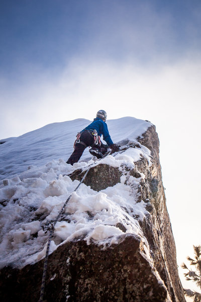 """Clean lead ascent under 6"""" of snow! The face is slick enough when it's dry, let alone covered in snow and ice! The technique through the crux ended up being propping myself up on my knees while """"campusing"""" between layback holds on the arete. Wild!"""