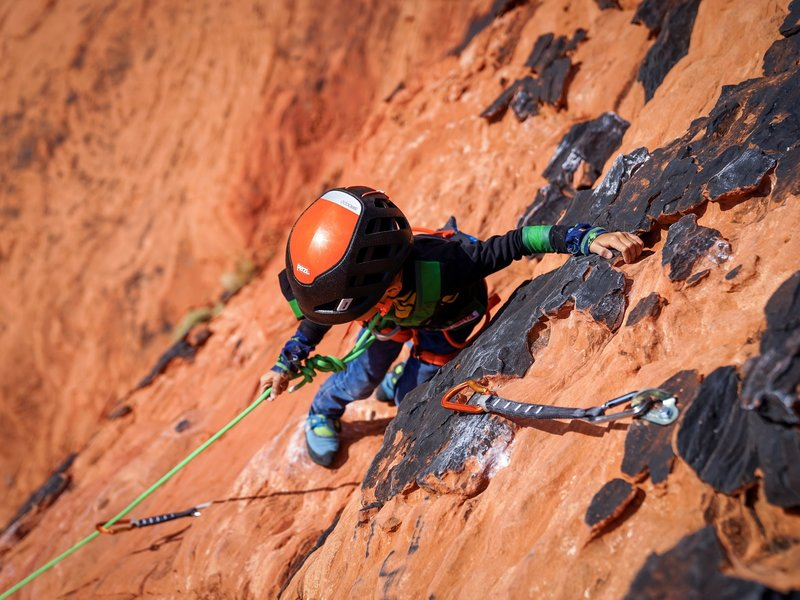 Bishop (6) pulling up rope on his first 5.7 outdoor lead