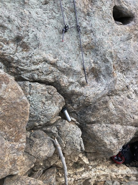 Knot your rope. A 60m isn't really long enough - the GriGri here is about 6 feet above the belay ledge - the belayer will have to climb up a bit to completely lower a lighter climber (with less rope stretch).