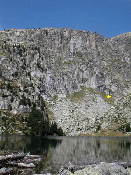 """Photo 17 - Estany Redo and the cliff beyond it. For scale, the tan """"dot"""" that bthe arrow points to is a cow !"""