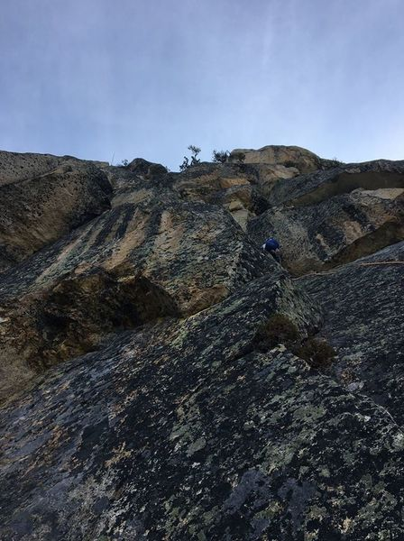 Here is a bad photo of the 10c crux pitch. Ben led right to a dirty crack then back left up a ramp to a horizontal right finger crack. The finger crack in corner seems like the obvious route, but it did not seem to go. Likely has fixed nut.