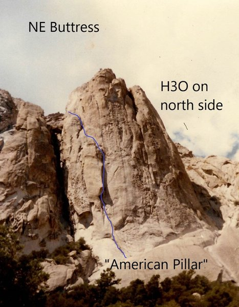 "A.K.A., ""Rocco's Wall"". American Pillar route (5.10, 1981) is shown. H3O (5.11, 1982) is around the corner. Also, a 5.9R route (The Milk Bottle, 1979?) works its way up the crack system descending from just right of the summit."