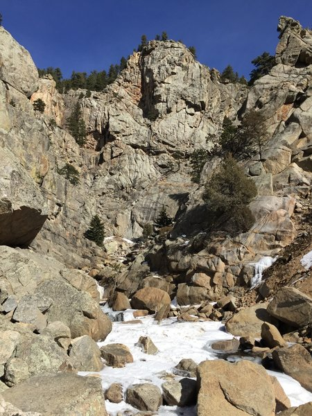 A frozen North Boulder Creek with Lower Dream Canyon rock looming above. L > R: Plotinus, Krishna, Berlin Wall, Wall of Winter Warmth, Pin Dome.
