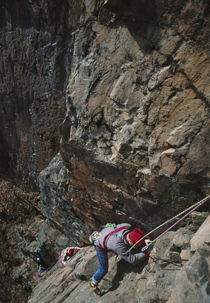 belaying Kim Smith while Ken Nichols and friend follow closely behind. In the background is the well chalked up 'Cat Crack' - Nov 1987