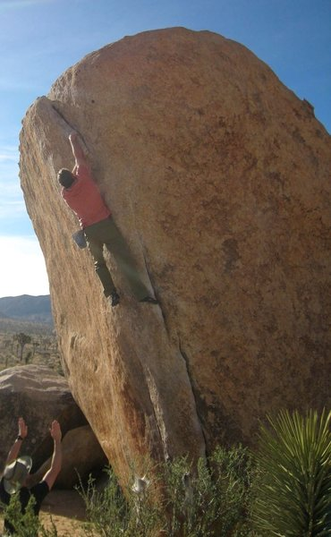 David Katz just passing the crux move reaching out left