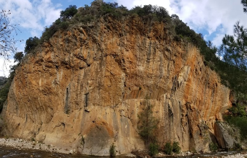 A panorama of Kabe. Walk across the stream to access the base of the cliff.