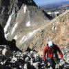 Scrambling through the scree after the lower saddle to the start