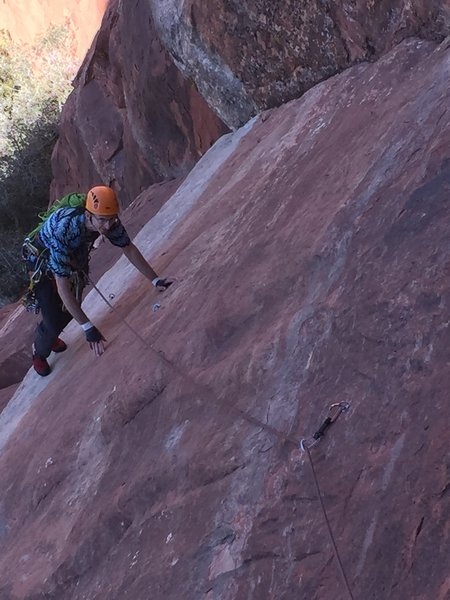 Keith coming up through the crux slab on P1.The crux is a bit slippery but well protected.