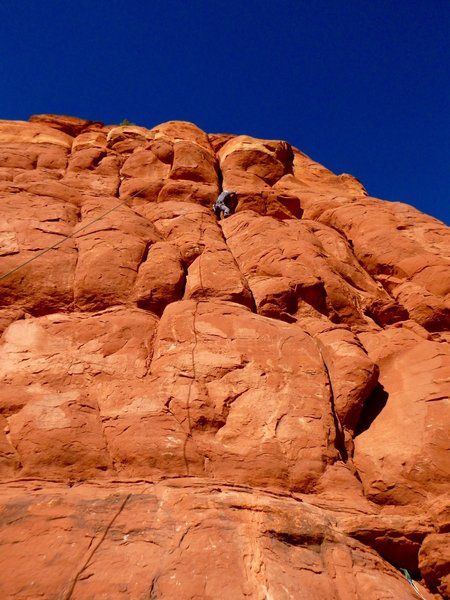 """Doug Biber himself came wandering along and accepted our invitation for a toprope burn. """"This is very different from Nirvana!"""" he laughed. Here he is wrestling with one of the crux bulges, roughly one-third of the way up."""