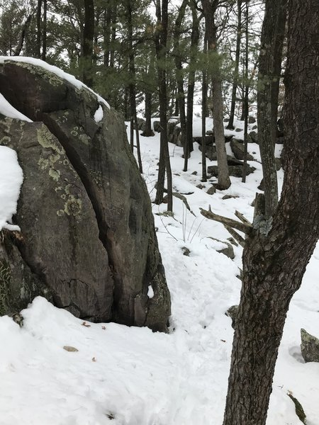 The boulder from the left