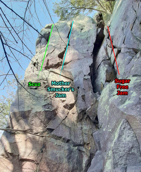 Sugar Free Jam, Scuz, and Mother Smucker's Jam. Scramble halfway up between the 2 towers to start these climbs.