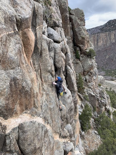 Pulling into the redpoint crux of the route.