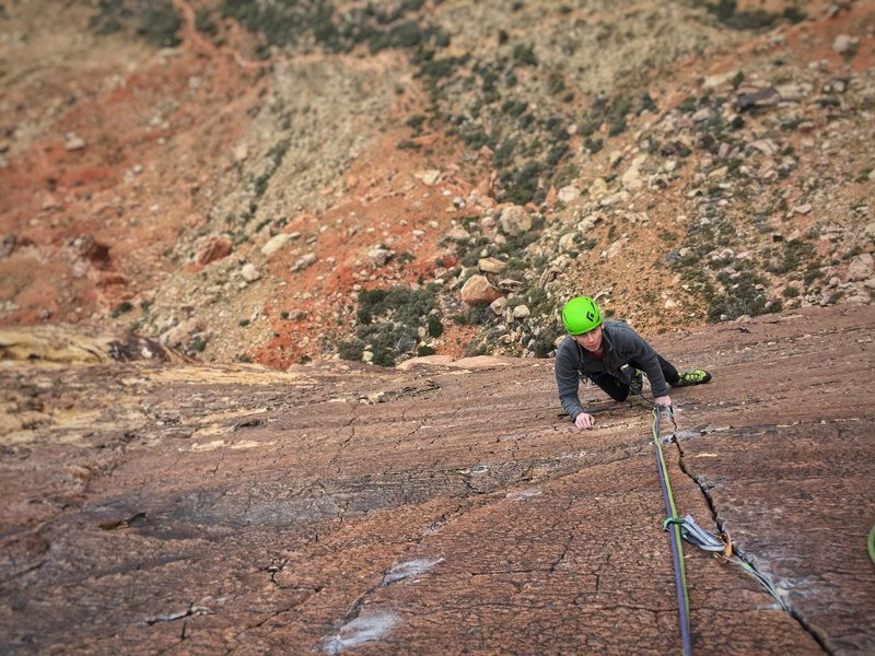 Thin patina climbing in 40mph winds! Photo by Dave Allfrey.