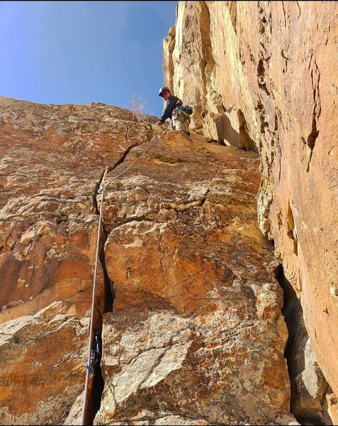 Can be climbed as a crack or a face climb