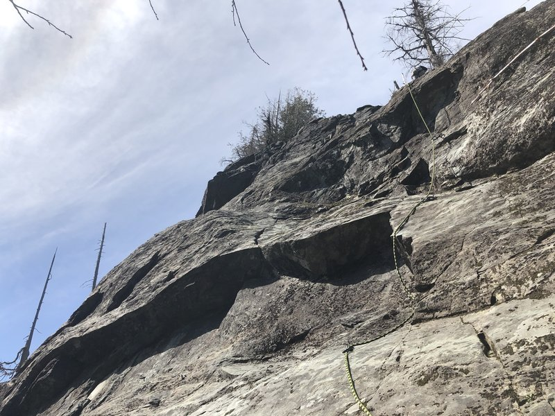 Partner knocking out his second sport lead. With high snow levels we started two-three bolts up and had awkward belay stance. No move was harder then 5.7. He crushed it.